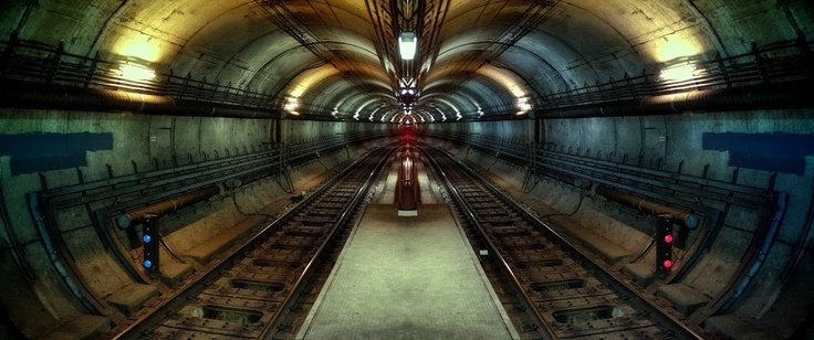 Underground railway to infinity - one of my stranger manipulated shots. This is Parliament Station. Shot on X100