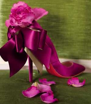 Fuchsia footwear is even more fabulous when finished with an Yves Piaget rose. Shoe, Christian Louboutin, christianlouboutin.fr.