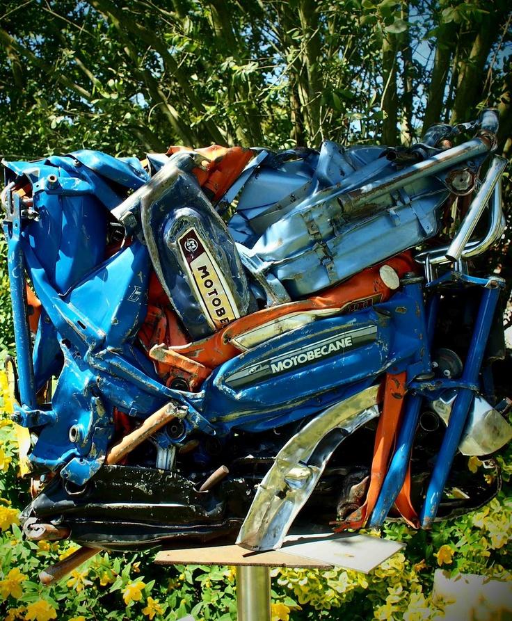 Got a few used mopeds beyond repair?  Make art.