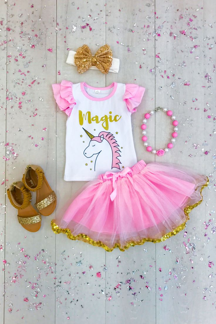 """Magic"" Unicorn Tutu Skirt Set This ""Magic"" unicorn tutu skirt set is super cute and perfect for your little princess! ""Magic"" written in gold writing on the front with a unicorn, paired with a matching pink tutu skirt with gold sequin trim. She will be the star of the show in this stunning outfit!"