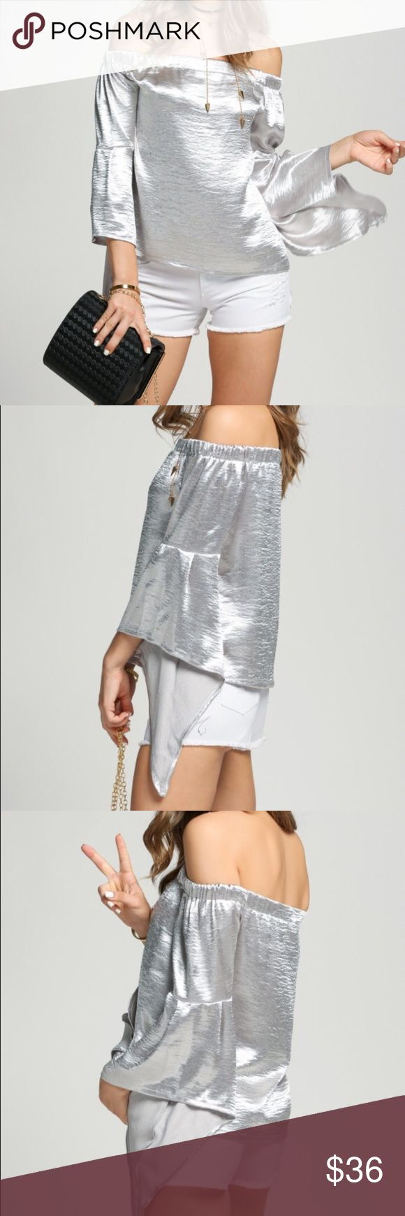 ‼️final price ‼️Off the shoulder metallic blouse Off the shoulder metallic blouse. 100% polyester. 3/4 bell sleeve. New without tags retail. Never worn. Ships within one week. ‼️no offers accepted clearance pricing ‼️ ShopNicety Tops