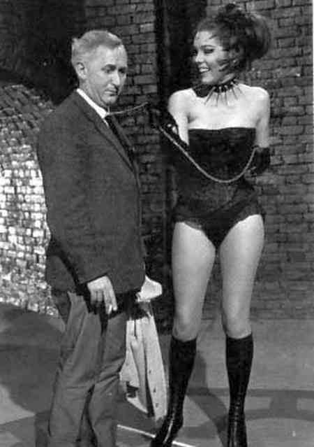 Director James Hill and Diana Rigg, larking about, havin' a laugh between takes on the set of 'The Avengers' in Season 4, Episode 21 'A Touch of Brimstone', wherein Mrs Emma Peel, played 'The Queen of Sin' (originally aired 19 February 1966)