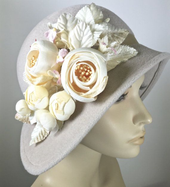 Meet the Miss Fisher hat in an alabaster (off white) color fur felt hat. The hat brim is wired for stability with plastic milliners wire.