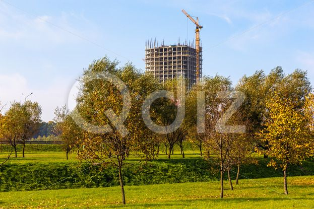 Qdiz Stock Photos | Building crane on construction,  #architecture #blue #build #building #built #business #City #construct #construction #crane #development #engineering #equipment #estate #grass #green #growth #house #industrial #industry #modern #site #sky #steel #technology #tree #urban #work