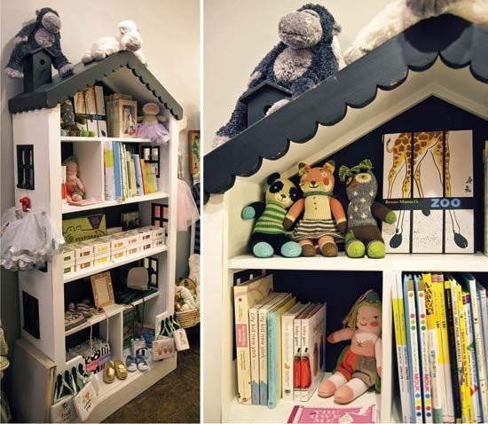A thin dollhouse shelf unit is a cute display fixture and works well to display a variety of children's products.