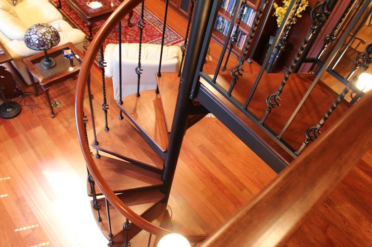 Forged Iron Spiral Stair With Brazilian Cherry Treads And Handrail