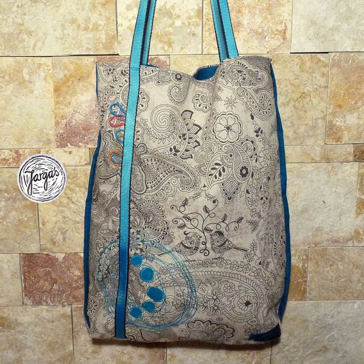 Ornamental bag with blue rope and design inspired by climbing.