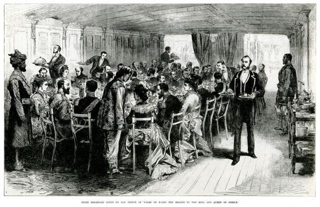 1875. Πρόγευμα στο HMS SERAPIS. Ο Πρίγκιπας της Ουαλίας, αργότερα Εδουάρδος Ζ΄ της Αγγλίας, παραθέτει πρόγευμα στο ελληνικό βασιλικό ζεύγος στο πλοίο του. https://en.wikipedia.org/wiki/HMS_Serapis_%281866%29