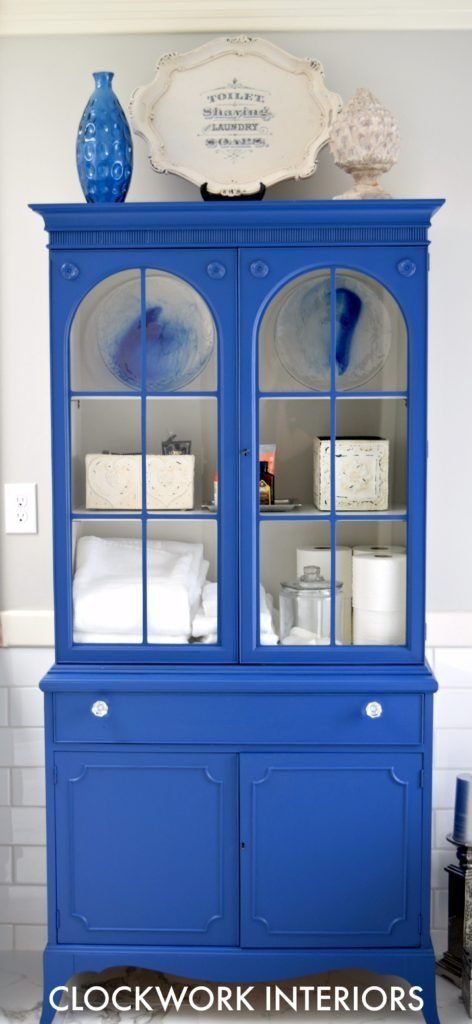 China cabinet is updated with paint and used as bathroom storage / Clockworkinteriors.com