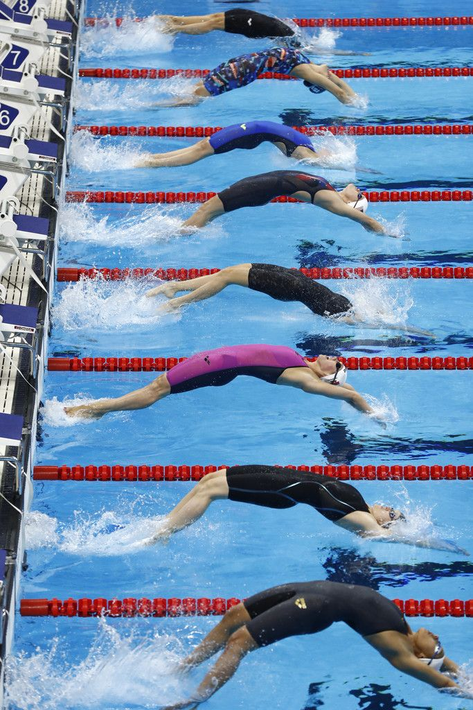 (From top) Czech Republic's Simona Baumrtova, Iceland's Eyglo Gustafsdottir, Russia's Daria Ustinova, USA's Olivia Smoliga, Australia's Madison Wilson, Russia's Anastasiia Fesikova, Zimbabwe's Kirsty Leigh Coventry and Finland's Mimosa Jallow compete in the Women's 100m Backstroke heats during the swimming event at the Rio 2016 Olympic Games at the Olympic Aquatics Stadium in Rio de Janeiro on August 7, 2016.   / AFP / Odd ANDERSEN
