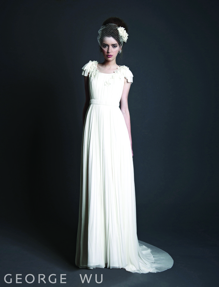 Fleurblanc Dress - Grecian style of draping from very fine silk sheer fabric with hand embroidered French lace flowers set with Swarovski crystals. Waist band belt worn separately. Dress lined in silk. Made in Australia.  Repin for your own #wedding #inspiration.  #bridal #couture #design #gowns #lace