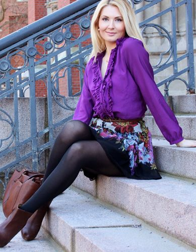 Anna-Maria wearing lilac and flowers with brown leather.
