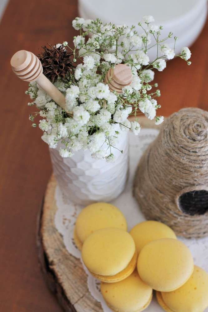Lovely macarons at a bumblebee baby shower party! See more party planning ideas at CatchMyParty.com!
