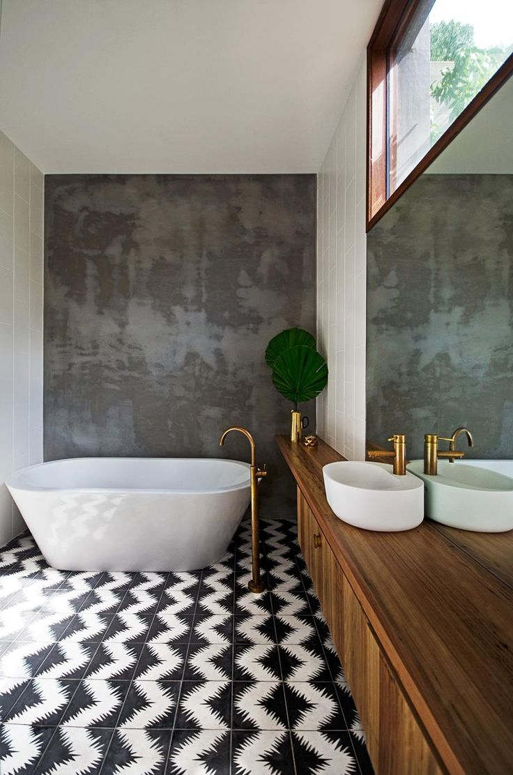 "Brass tapware in this earthy bathroom by [Auhaus Architects](http://auhaus-arch.com/?utm_campaign=supplier/|target=""_blank"") adds instant warm and pairs beautifully with the timber vanity. Photo: Trevor Mein"
