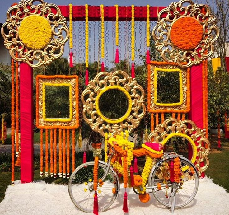 Beautiful photo booth for sangeet ceremony mehndi for Sangeet decorations at home