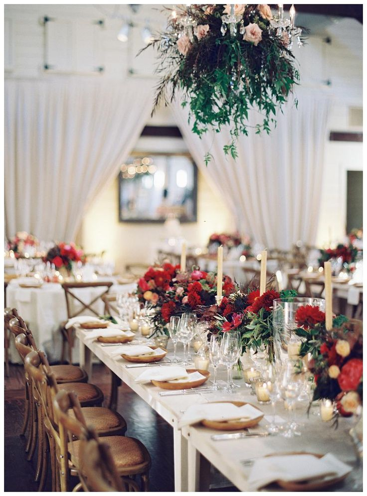 Fall wedding reception table with brilliant red florals for Wedding reception table linen ideas