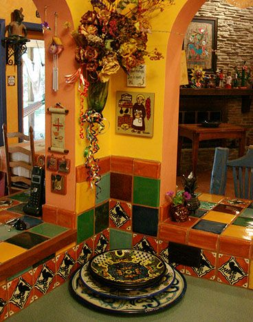 Mexican Colored Kitchen..I love that pale peach that anchors all the colors.
