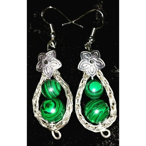 Silver wire and malachite earrings made in vikingebinding technique.