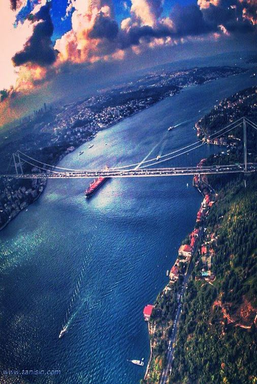 "The Bosphorus, Istanbul, Turkey .  It is not a river, it is a ""waterway"" linking two seas -- the Black Sea to the Marmara Sea.  8,000 years ago, it was land, and the Black Sea was a very large lake .  On the left is Europe or Avrupa, on the right is Asia or Anadolu, and the bridge obviously links the two continents, the only one that does that in the world . Make sure to take a public ferryboat ride up and down the Bosphorus."