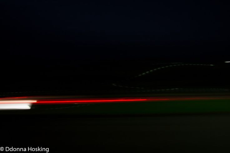 Tv mode motion blur exposure .08 second f/4.0 FL 27 mm ISO 100 showing tail lights of car in motion