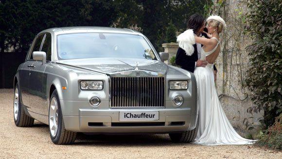 This couple chose a brand-new silver Rolls Royce Phantom as their wedding transportation.
