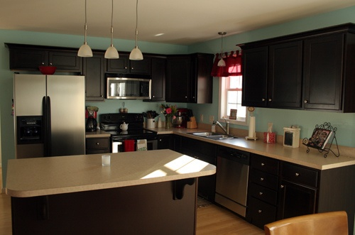 These cabinets are right, but the counter tops need to be a little different, and a backsplash rather than painted walls