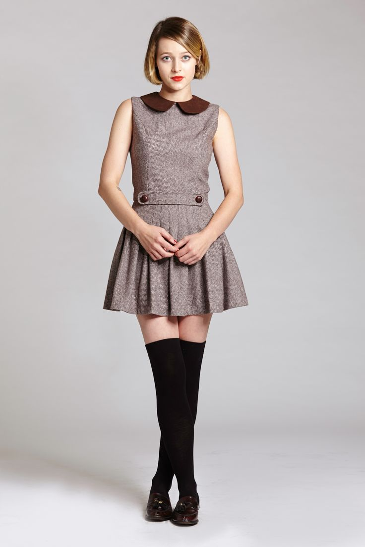 Brown Ecoliere Dress Brown wool sleeveless pleated school girl dress. (Please note that some of the dresses may run small, please see our FAQS...
