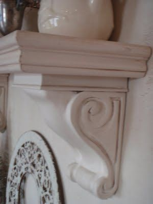 diy mantel with trim and corbel ... this blog also has a cool playlist!  =)