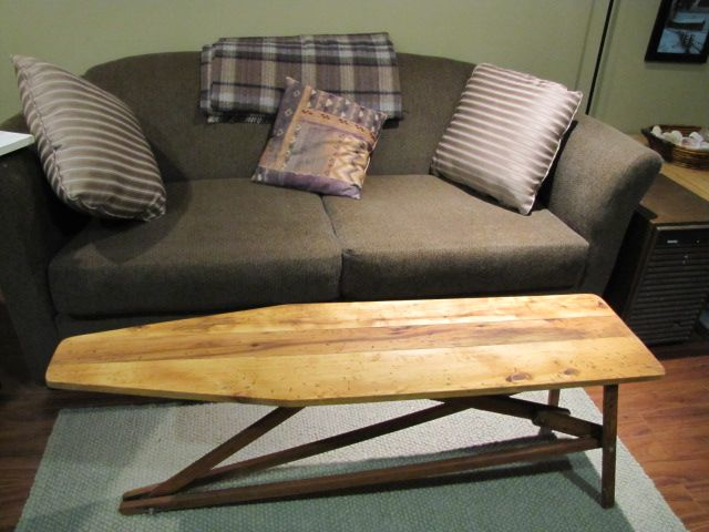 Antique ironing board coffee table