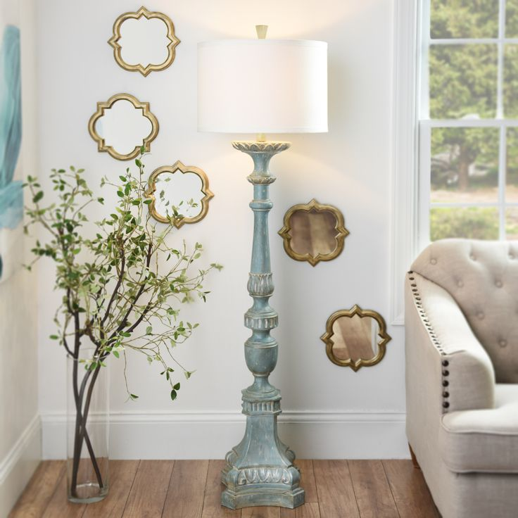 Don't sacrifice style for lighting! instead, add the Alana Distressed Blue Floor Lamp to your living room and bring extra light along with extra style. Plus, the distressed blue finish adds a pop of color where you need it!