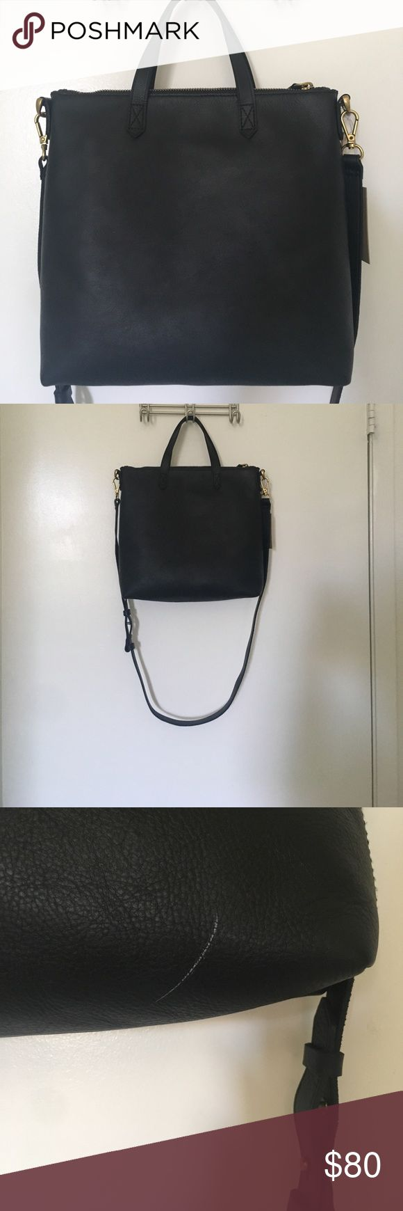 Madewell mini transport tote Black leather mini transport tote by Madewell. Zipper closure. Detachable shoulder strap. Pockets inside. Brand new, never used, tags still attached. Has white scratch that is 1.5in. long on bottom corner. Madewell Bags Mini Bags