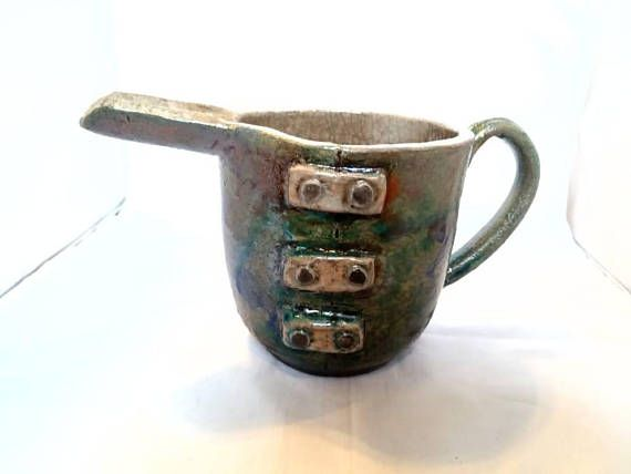 Check out this item in my Etsy shop https://www.etsy.com/listing/583729863/raku-pottery-jug