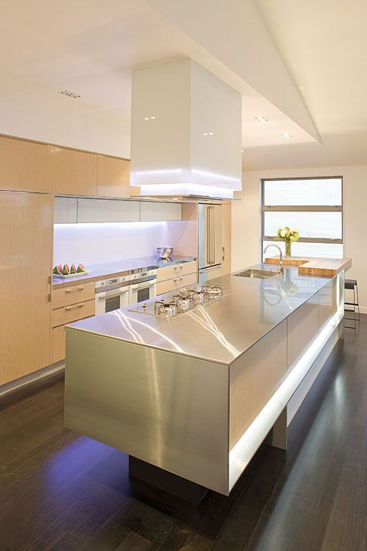 dark wood floor and light wood cabinetry. Very streamlined and lots of use of white and aluminium.