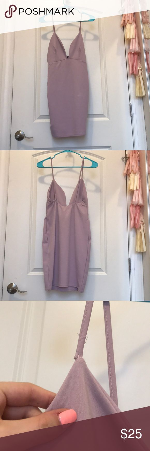 NWT Missguided Dress Gorgeous NWT mauve colored dress is perfect for any occasion! Deep v front and low back. Spaghetti straps, form-fitting shape. Small rip on one strap and in the front but could easily be fixed and not noticeable. Missguided Dresses Mini