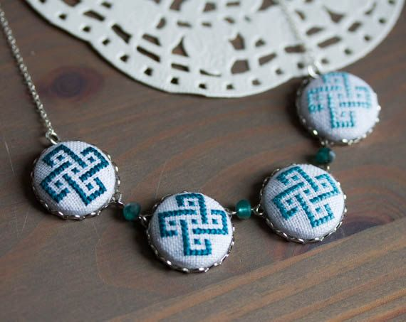 Teal blue ombre necklace made with 4 cross stitch ornaments. • Each button is 2 cm / 0.8 diameter • Modeled length of necklace is 65 cm / 26. • All