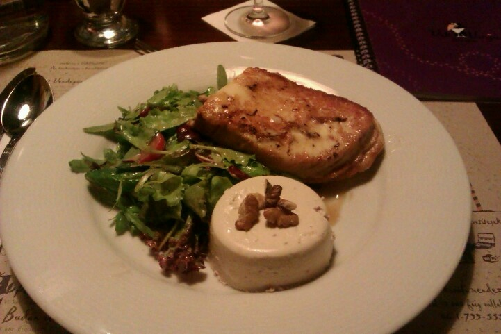 Grilled sheep's milk cheese with walnut panna cotta and grape-seed oil kissed green salad