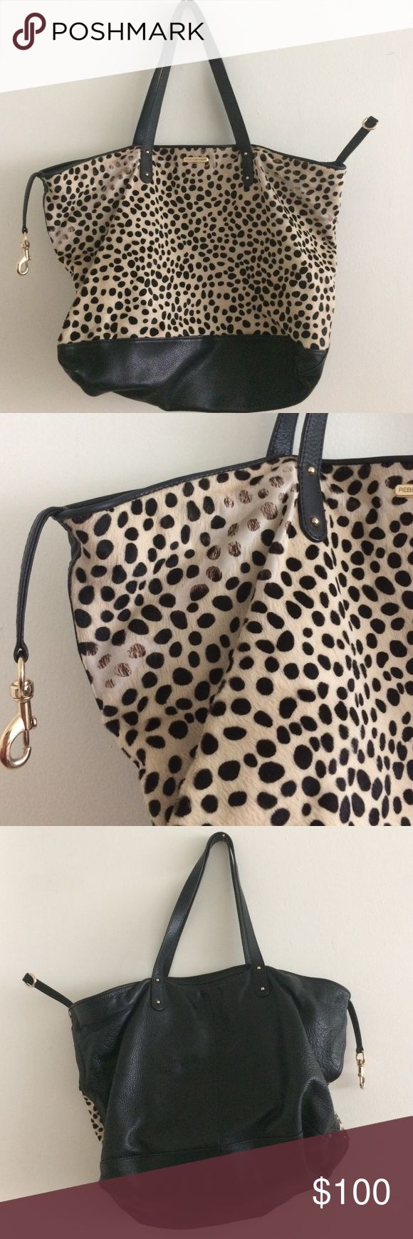 Rebecca minkoff vow hair and leather purse Black leather mixed with spot cow hair. Big bad with interior zip pocket. Cow hair is rubbing off on some places otherwise good condition Rebecca Minkoff Bags Totes