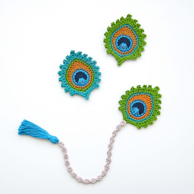 The crochet peacock feather applique or motif is my own original design. It measures approx. 9 x 7.5 cm / 3.6 x 3 inch and I make it using 100% mercerized cotton and a 3mm hook / D hook.