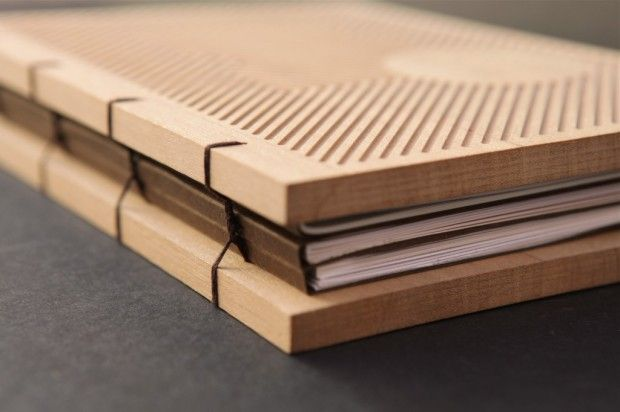 Llibre Homenatge (Tribute Book) is an absolutely stunning book, with an engraved wood cover and exposed binding, designed by Barcelona-based design studio Petit Comitè. Gorgeous work.