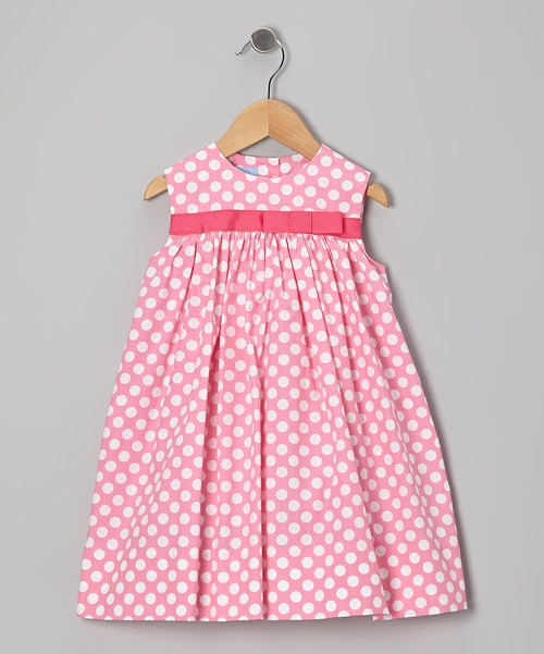 This lovable, lightweight dress features perfectly precious fabric and a ribbon stripe tied with a bow. Cut for comfort, it has buttons in back so it's easy to change too.80% cotton / 20% polyesterMachine washMade in El Salvador
