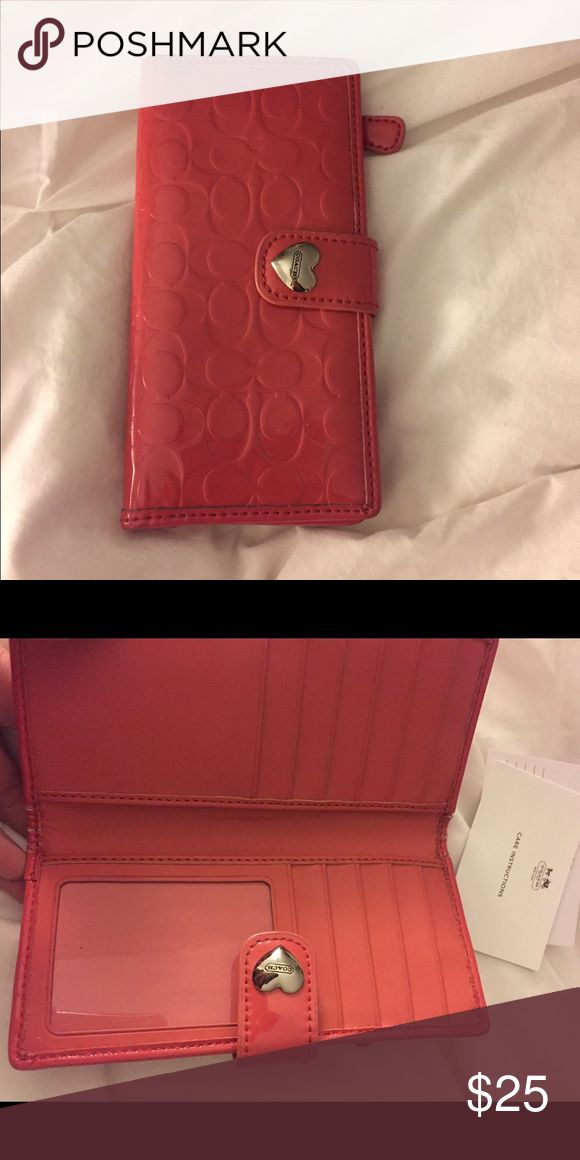 Coach Wallet Pink heart wallet, some signs of wear where it opens on the inside (see photo) Coach Bags Wallets