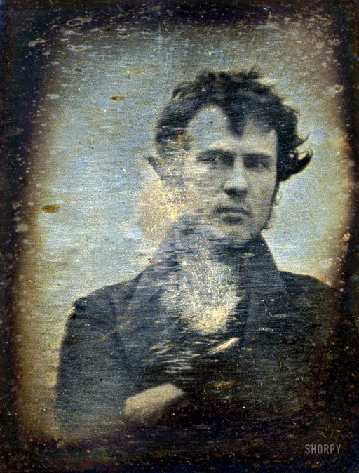 """Philadelphia, November 1839. """"Robert Cornelius, self-portrait facing front, arms crossed. Inscription on backing: The first light-picture ever taken. 1839."""" One of the first photographs made in the United States, this quarter-plate daguerreotype, taken in the yard of the Cornelius family's lamp-making business in Philadelphia, is said to be the earliest photographic portrait of a person."""