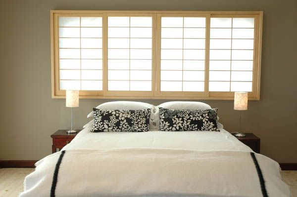 Shoji screens allow for soft light filtering into bedrooms by ADK Cabinetworks