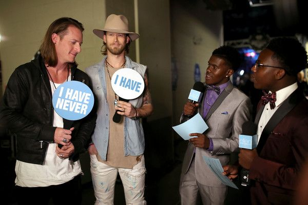 Brian Kelley Photos Photos - Musicians Tyler Hubbard (L) and Brian Kelley (2nd-L) of Florida Georgia Line attend the 2016 iHeartRadio Music Festival at T-Mobile Arena on September 24, 2016 in Las Vegas, Nevada. - 2016 iHeartRadio Music Festival - Night 2 - Backstage