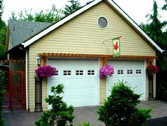 Hanging baskets and arbor over garage doors  Gardening and Outdoor Spaces in 2019  Garage