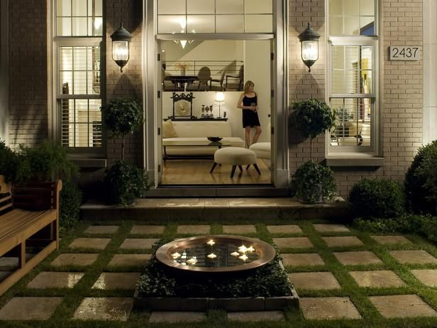 Outdoor spaces on a budget. Create an elegant, intimate space with candles. Designer Greg Schaumburg of Hursthouse Landscape Architects Contractors filled a copper basin with water and floating tea lights for the perfect way to light an outdoor party.