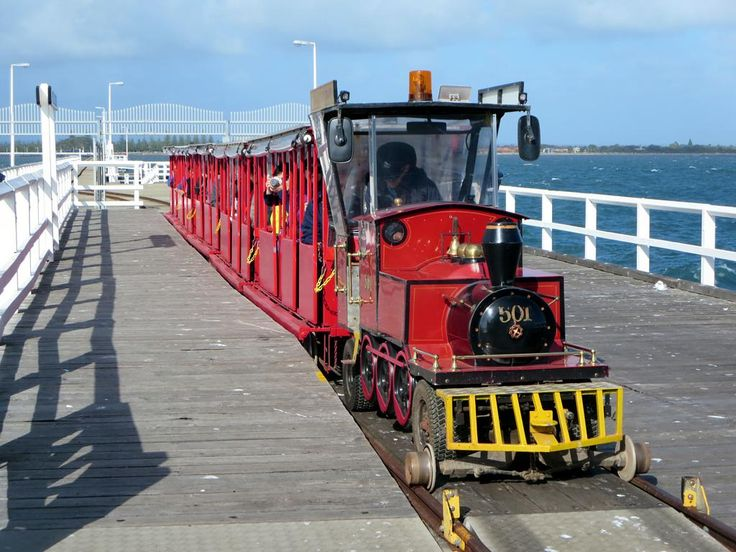 A miniature railway on the Busselton Jetty at Busselton, Western Australia, carries visitors to an Underwater Observatory.