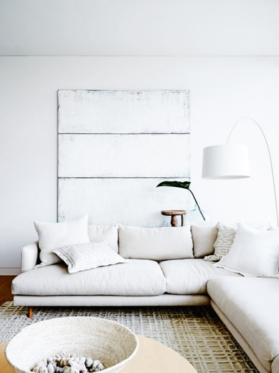 Eclectic beach home in Sydney. White sectional. Photo by Anson Smart via Vogue Living
