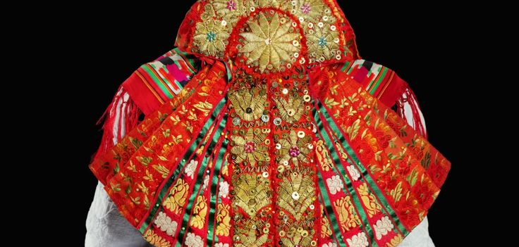 """The """"Brett"""" is a kind of double fan made of nine artfully embroidered ribbons, the back and neck decorated, usesd at the fairgrounds in the Hessian Schwalm-Eder-Kreis,"""