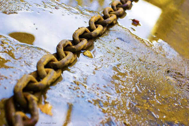 less elements, rusted iron chain, water puddle, chained, chains, minimalist, minimalism, minimalist photographers, less is more, buy photos online, buy art online, online shopping, indian photographers, fine art photography, bloggers, photography blogs, learn photography, types of photography. low angle shots, street shots, still life photography, photo art, buy home decor, buy canvas prints, online shopping, prakash ghai, #learnminimalism